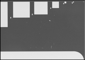 Fig. 1b: The portion of the fabricated sample showing patterned electroplated squares, rectangles and circles having varying areas.