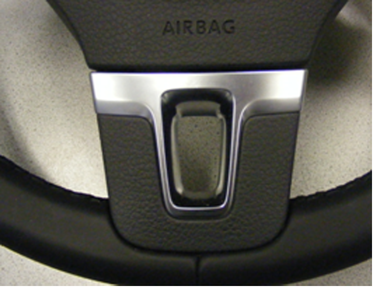Fig. 1: Steering wheel with integrated decorative chromed bezel