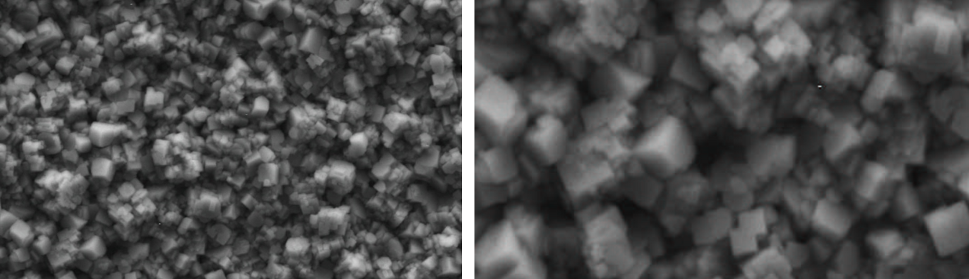 Fig. 13: SEM image of deposit obtained with SWPO treatment. EU =-0.20 V. a) 10000X; b) 25000X.